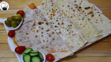 Photo of خبز الصاج او خبز بفليفلة و جبنة بعجينة ناجحة و سهلة و سريعة (فيديو)